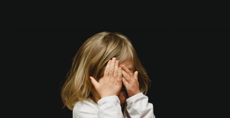 Child rubbing their eyes