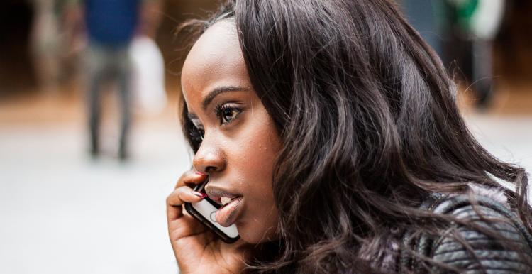 A woman taking a phone call.
