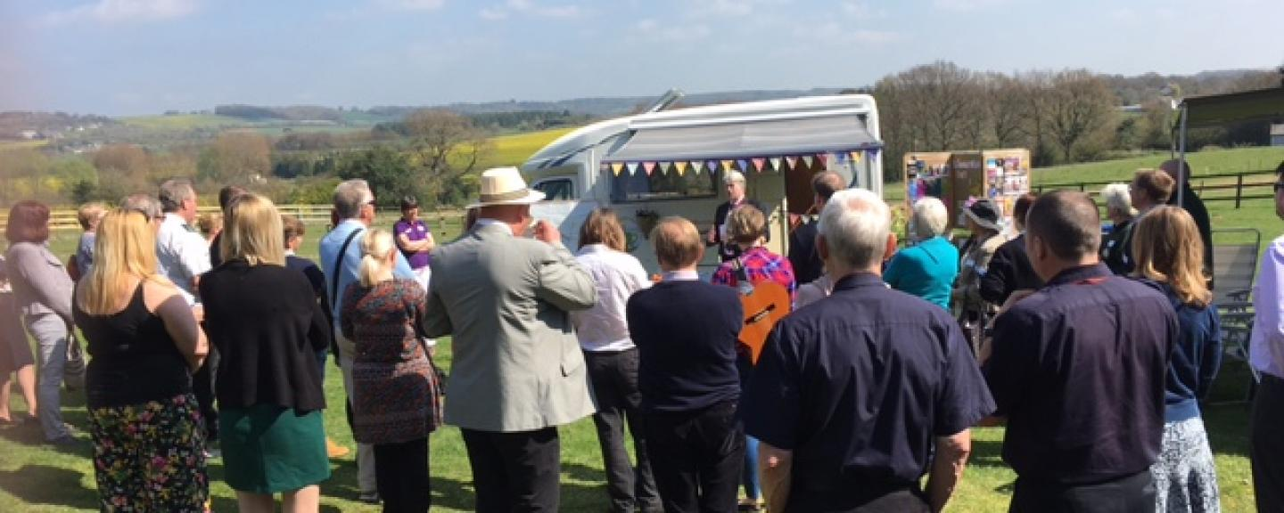 A group of people sitting and chatting at the Rural Kent Coffee Caravan