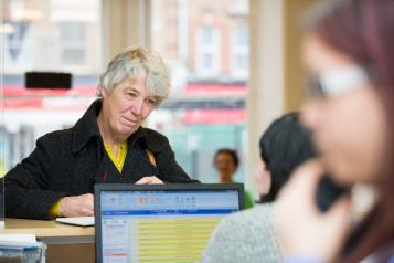 Woman at a GP reception desk