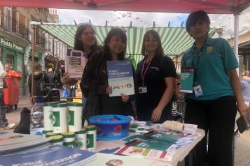 Members from Healthwatch, Dartford Gravesham & Swanley CCG and One You Kent  standing at their stall on Dartford Market Street