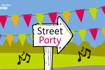 "East Kent Mencap's graphic of a wooden arrow-shaped sign, saying ""street party"", surrounded by bunting and green fields."
