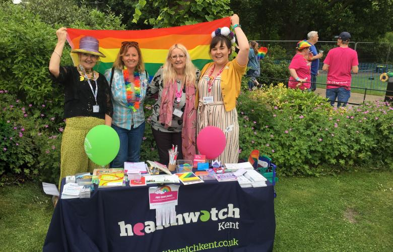 A picture of the team holding a rainbow flag at Canterbury Pride in 2018